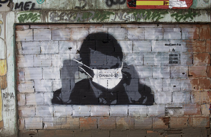A graffiti of Brazil's President Jair Bolsonaro wearing a protective mask in Rio de Janeiro, Brazil, Tuesday, April 7, 2020. Brazil is in the midst of a pitched battle over the effectiveness of isolation to avoid the spread of the new coronavirus, with Bolsonaro dismissing the virus' severity and publicly taking aim at governors who impose shutdowns that he says could cripple the economy. (AP Photo/Silvia Izquierdo)
