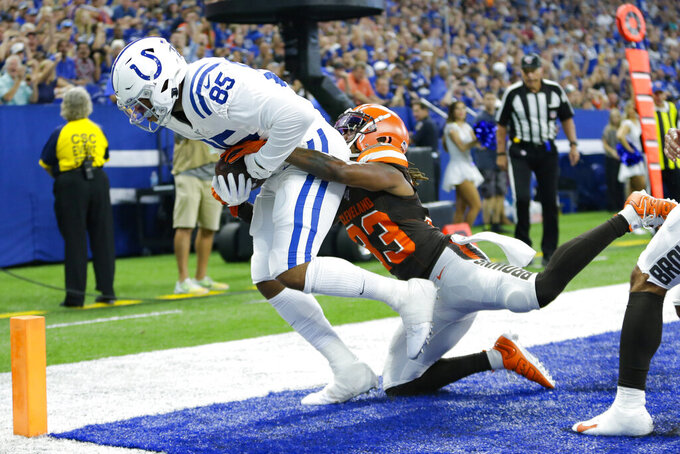 Indianapolis Colts tight end Eric Ebron (85) makes a catch for a touchdown as he is hit by Cleveland Browns defensive back Sheldrick Redwine (33) during the first half of an NFL preseason football game in Indianapolis, Saturday, Aug. 17, 2019. (AP Photo/AJ Mast)