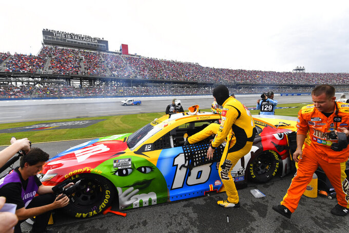 Kyle Busch gets in his car for a NASCAR Cup series auto race Sunday, Oct. 3, 2021, in Talladega, Ala. The race was postponed until tomorrow due to wet weather during a pace lap. (AP Photo/John Amis)