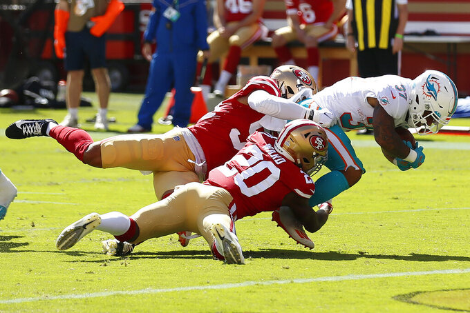 Miami Dolphins running back Myles Gaskin (37) runs against San Francisco 49ers middle linebacker Fred Warner, left, and free safety Jimmie Ward (20) during the first half of an NFL football game in Santa Clara, Calif., Sunday, Oct. 11, 2020. (AP Photo/Jed Jacobsohn)