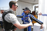 Ricky Stenhouse Jr., right, goes through a security checkpoint before the drivers meeting for the NASCAR Daytona 500 auto race at Daytona International Speedway, Sunday, Feb. 16, 2020, in Daytona Beach, Fla. Extra security measures were taken at the speedway because of the visit of President Donald Trump. (AP Photo/Reinhold Matay)
