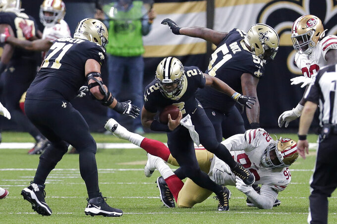 New Orleans Saints quarterback Jameis Winston (2) tries to avoid a sack by San Francisco 49ers defensive end Kerry Hyder (92) in the second half of an NFL football game in New Orleans, Sunday, Nov. 15, 2020. (AP Photo/Brett Duke)