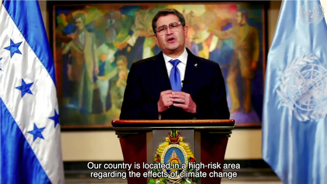 In this image made from UNTV video, Juan Orlando Hernandez Alvarado, President of Honduras, speaks in a pre-recorded message which was played during the U.N. General Assembly's special session to discuss the response to COVID-19 and the best path to recovery from the pandemic, Thursday, Dec. 3, 2020, at U.N. headquarters, in New York. (UNTV via AP)