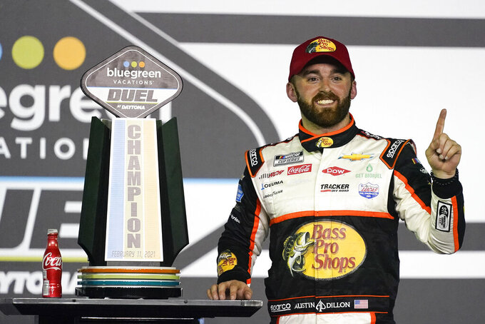 Austin Dillon celebrates in Victory Lane after winning the second of two qualifying auto races for the NASCAR Daytona 500 at Daytona International Speedway, early Friday, Feb. 12, 2021, in Daytona Beach, Fla. (AP Photo/John Raoux)