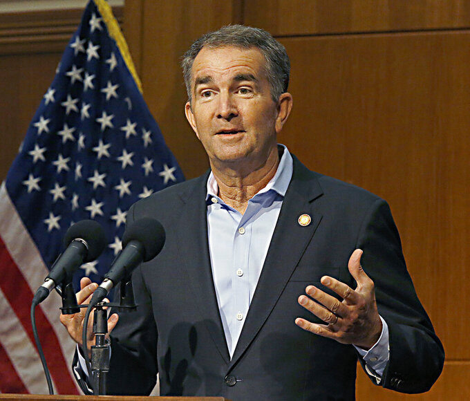 Virginia Governor Ralph Northam announces that all state workers must be vaccinated or face weekly testing for COVID-19 as he speaks to reporters inside the Patrick Henry Building in Richmond, Va., Thursday, Aug. 5, 2021. (AP Photo/Richmond Times-Dispatch, Bob Brown)./Richmond Times-Dispatch via AP)