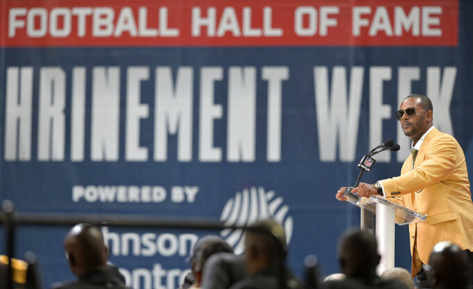 Former NFL player Ty Law speaks during the induction ceremony at the Pro Football Hall of Fame, Saturday, Aug. 3, 2019, in Canton, Ohio. (AP Photo/David Richard)