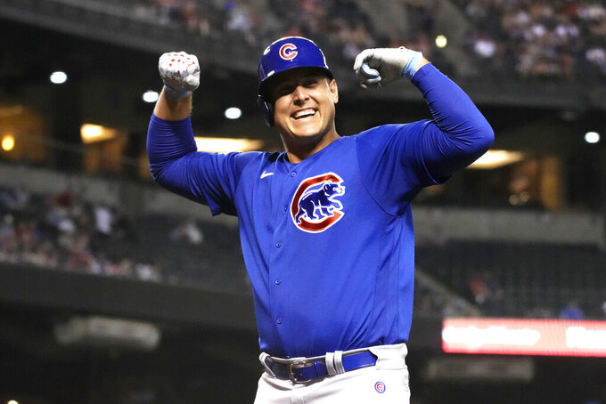 Chicago Cubs' Anthony Rizzo reacts after hitting a solo home run against the Arizona Diamondbacks in the fourth inning during a baseball game, Friday, July 16, 2021, in Phoenix. (AP Photo/Rick Scuteri)