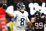 Tennessee Titans quarterback Marcus Mariota (8) works against the Atlanta Falcons during the first half of an NFL football game, Sunday, Sept. 29, 2019, in Atlanta. (AP Photo/John Bazemore)