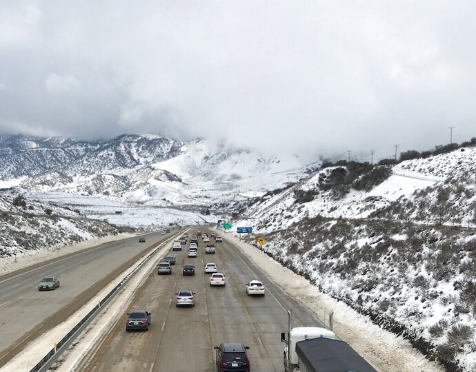 In this Feb. 18, 2019 photo released by the California Highway Patrol Central Division shows traffic open on Interstate I-5 over Grapevine, Calif. Two major Southern California highways were reopened Monday, Feb. 18, 2019, after ice and blowing snow forced closures that stranded hundreds of motorists, including some who spent a frigid night in their vehicles. Traffic started moving again around 11 a.m. in northbound lanes of Interstate 5 at the Grapevine, a high pass along the key route between Los Angeles and San Francisco, the California Highway Patrol said. The southbound side was reopened a few hours earlier but officials warned that icy conditions persist. (California Highway Patrol Central Division via AP)