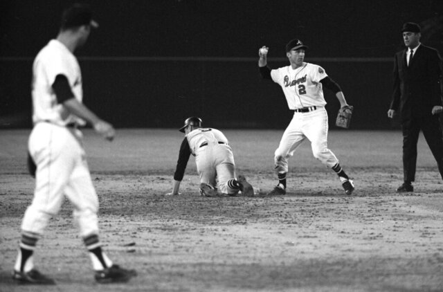 FILE - In this April 12, 1966, file photo, Atlants Braves second baseman Frank Bolling (2) throws the ball against the Pittsburgh Pirates during the first Major League Baseball game in the southeast at Atlanta-Fulton County Stadium. Bolling, a two-time All-Star second baseman and the last player to hit a grand slam off Sandy Koufax, has died. He was 88. Bolling died Saturday, July 11, 2020. (Marion Crowe/Atlanta Journal-Constitution via AP, File)