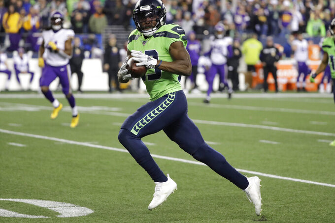 Seattle Seahawks' David Moore races toward the goal line for a touchdown on a 60-yard pass reception against the Minnesota Vikings during the second half of an NFL football game, Monday, Dec. 2, 2019, in Seattle. (AP Photo/Ted S. Warren)