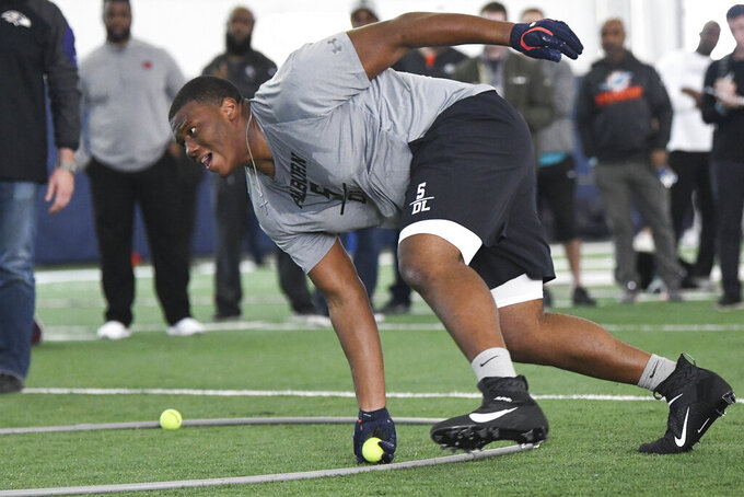 Defensive tackle Derrick Brown runs through defensive drills during Auburn NCAA college football Pro Day, Friday, March 6, 2020, in Auburn, Ala. (AP Photo/Julie Bennett)