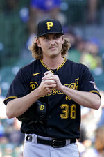 Pittsburgh Pirates relief pitcher Nick Mears rubs the ball during the seventh inning of a baseball game against the Chicago Cubs in Chicago, Sunday, Sept. 5, 2021. (AP Photo/Nam Y. Huh)