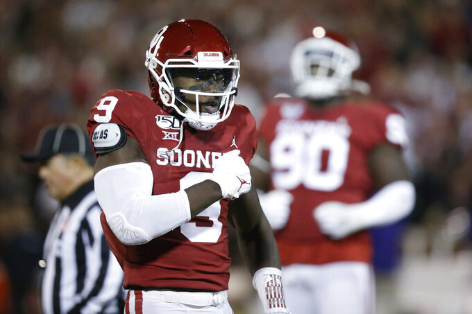 FILE - In this Saturday, Nov. 23, 2019 file photo, Oklahoma linebacker Kenneth Murray (9) celebrates a tackle during an NCAA college football game against TCU in Norman, Okla. Major improvements on defense have pushed Oklahoma and Baylor into the Big 12 championship game. Oklahoma led the Big 12 in total defense during conference play after finishing last a season ago. Baylor led the Big 12 in scoring defense and ranked third in total defense in league play a year after finishing seventh in total defense and eighth in scoring defense.(AP Photo/Sue Ogrocki, File)