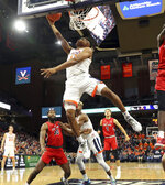Virginia guard Casey Morsell (13) shoots over Stony Brook defenders during an NCAA college basketball game in Charlottesville, Va., Wednesday, Dec. 18, 2019. Virginia won 56-44. (AP Photo/Andrew Shurtleff)