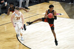 Oregon State guard Gianni Hunt grabs a rebound over Loyola Chicago guard Tate Hall (24) during the first half of a Sweet 16 game in the NCAA men's college basketball tournament at Bankers Life Fieldhouse, Saturday, March 27, 2021, in Indianapolis. (AP Photo/Darron Cummings)