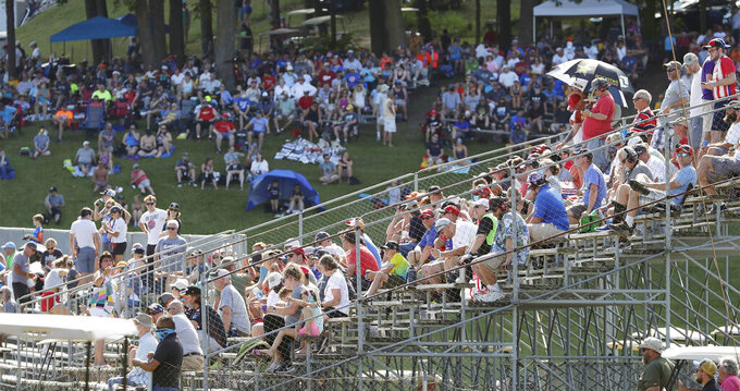 People fill the stands near Turn 5 during the REV Group Grand Prix auto race one, Saturday, July 11, 2020, in Elkhart Lake, Wis. IndyCar driver Scott Dixon won the event. (Gary C. Klein/The Sheboygan Press via AP)