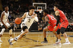 Vanderbilt guard Scotty Pippen Jr. (2) drives against Southeast Missouri State guard Oscar Kao (4) in the first half of an NCAA college basketball game Wednesday, Nov. 6, 2019, in Nashville, Tenn. (AP Photo/Mark Humphrey)