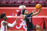 Georgia guard Sahvir Wheeler (2) gets a layup past Alabama guard Keon Ellis (14) during the first half of an NCAA basketball game on Saturday, Feb. 13, 2021, in Tuscaloosa, Ala. (AP Photo/Vasha Hunt)
