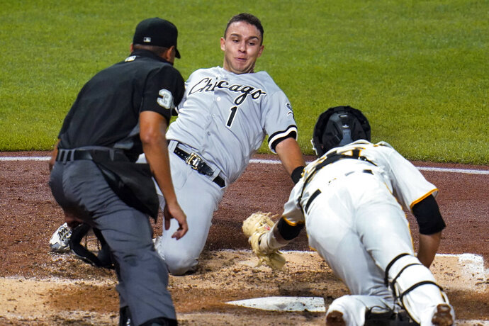 Chicago White Sox's Nick Madrigal (1) is tagged out by Pittsburgh Pirates catcher Jacob Stallings while attempting to score on a single by Tim Anderson during the fifth inning of a baseball game in Pittsburgh, Tuesday, Sept. 8, 2020. Watching is umpire Jeremie Rehak. (AP Photo/Gene J. Puskar)