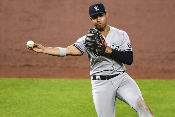 New York Yankees shortstop Gleyber Torres (25) records put out during the eighth inning of a baseball game against the Baltimore Orioles on Monday, April 26, 2021, in Baltimore, Md. (AP Photo/Terrance Williams)