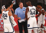 Memphis Grizzlies head coach Taylor Jenkins, center, reviews a play with his players during a timeout against the Oklahoma City Thunder in the first half of an NBA basketball game Friday, Aug. 7, 2020, in Lake Buena Vista, Fla. (Kim Klement/Pool Photo via AP)