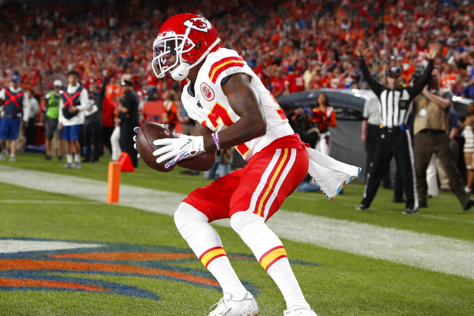 Kansas City Chiefs wide receiver Mecole Hardman (17) scores a touchdown against the Denver Broncos during the first half of an NFL football game, Thursday, Oct. 17, 2019, in Denver. (AP Photo/David Zalubowski)
