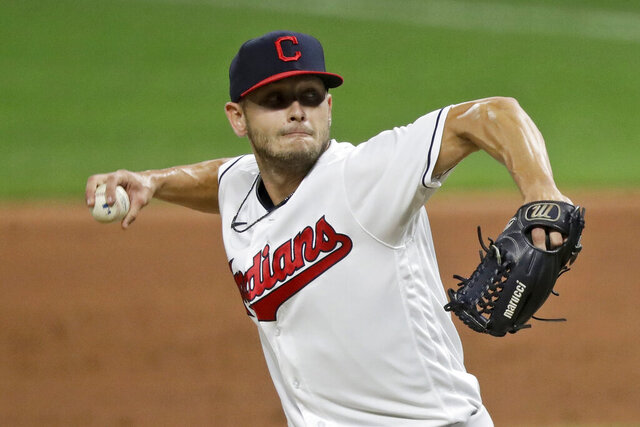 Cleveland Indians relief pitcher Cam Hill delivers in the ninth inning in the second game of a baseball doubleheader against the Chicago White Sox, Tuesday, July 28, 2020, in Cleveland. Indians rookie reliever Cam Hill underwent surgery Monday night, Nov. 30 on his right wrist, after being involved in a car accident in Tulsa, Oklahoma.(AP Photo/Tony Dejak)