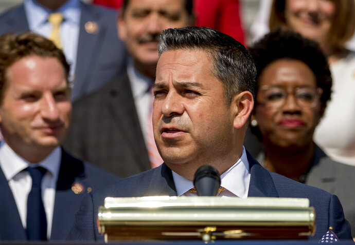 FILE - In this July 25, 2019 file photo Rep. Ben Ray Lujan, D-N.M., center, speaks as House Democrats hold a news conference in Washington. Federal grant programs aimed at preserving indigenous languages would be extended for a few more years and expanded to allow more American Indian tribes to participate under legislation that has cleared its final congressional hurdle. The U.S. House approved the measure Monday, Dec. 9, 2019.