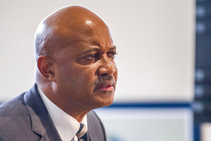 FILE - In this Oct. 3, 2019, file photo, Indiana Attorney General Curtis Hill holds a press conference in South Bend, Ind. Lawyers for Hill are trying to block two women from testifying about previous sexual misconduct allegations as he faces claims that he drunkenly groped four women at a bar last year. The state's attorney disciplinary commission wants the women to testify about Hill's actions when he was the Elkhart County prosecutor before becoming attorney general in 2017. (Robert Franklin/South Bend Tribune via AP, File)