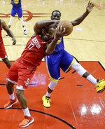Houston Rockets forward PJ Tucker, left, and Golden State Warriors forward Draymond Green vie for the ball during the second half of Game 3 of a second-round NBA basketball playoff series Saturday, May 4, 2019, in Houston. Houston won 126-121 in overtime. (AP Photo/Eric Christian Smith)