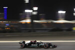 Mercedes driver Lewis Hamilton of Britain steers his car during the qualifying session for Sunday's Bahrain Formula One Grand Prix, at the Bahrain International Circuit in Sakhir, Bahrain, Saturday, March 27, 2021. The Bahrain Formula One Grand Prix will take place on Sunday. (AP Photo/Kamran Jebreili)