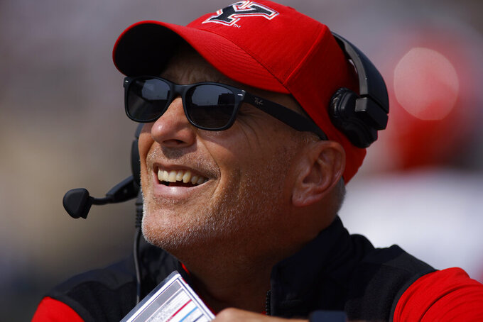 Youngstown State coach Doug Phillips watches from the sidelines during an NCAA college football game against Michigan State, Saturday, Sept. 11, 2021, in East Lansing, Mich. Michigan State won 42-14. (AP Photo/Al Goldis)