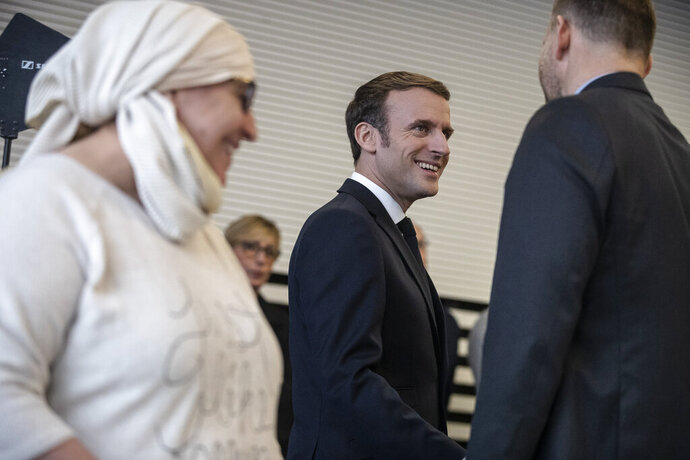 French President Emmanuel Macron, arrives for a meeting with associations, in Mulhouse, eastern France, Tuesday, Feb. 18, 2020. Macron said Tuesday he was determined to fight against