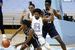 North Carolina guard Kerwin Walton (24) pressures Duke guard DJ Steward during the first half of an NCAA college basketball game in Chapel Hill, N.C., Saturday, March 6, 2021. (AP Photo/Gerry Broome)