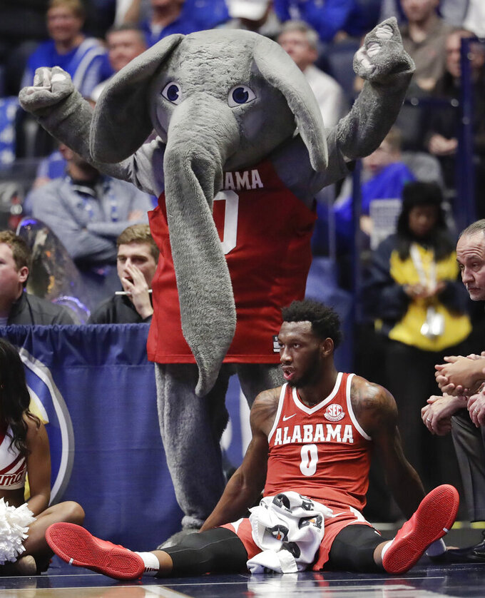 Alabama forward Donta Hall (0) watches the action as he sits in front of the team mascot in the first half of an NCAA college basketball game against Kentucky at the Southeastern Conference tournament Friday, March 15, 2019, in Nashville, Tenn. (AP Photo/Mark Humphrey)