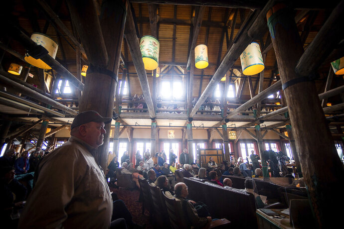 People fill the lobby of the Paradise Inn to watch during a grand opening event for the renovated Paradise Inn at Mount Rainier National Park in Paradise, Wash., on Friday, May 17, 2019. The Paradise Inn recently completed the second and final phase of a renovation project. (Joshua Bessex/The News Tribune via AP)