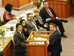 FILE - In this Thursday, Jan. 31, 2019, file photo, U.S. Rep. Ben Ray Lujan, of New Mexico, at podium, addresses the state Legislature in Santa Fe, N.M. In New Mexico's last election, Democrats not only expanded their majority in the state House but also claimed the governor's mansion after eight years of Republican control. By March 2019, Democratic Gov. Michelle Lujan Grisham had signed into law a bill that allows voters in the state to register and vote on the same day. Previously, registration closed 28 days before an election. (AP Photo/Morgan Lee, File)