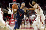 Auburn's Samir Doughty (10) tries to get past Arkansas Adrio Bailey, left, and Mason Jones (15) during the second half of an NCAA college basketball game Tuesday, Feb. 4, 2020, in Fayetteville, Ark. (AP Photo/Michael Woods)