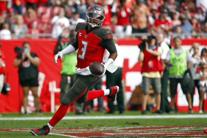 Tampa Bay Buccaneers quarterback Jameis Winston (3) scores on a two-point converion against the Atlanta Falcons during the first half of an NFL football game Sunday, Dec. 29, 2019, in Tampa, Fla. (AP Photo/Mark LoMoglio)