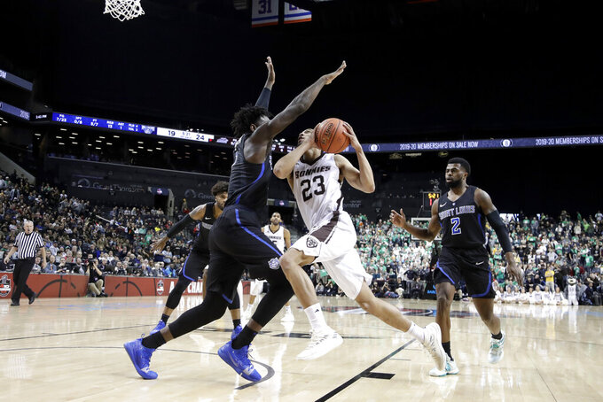 St. Bonaventure guard Jalen Poyser (23) drives to the basket against Saint Louis forward D.J. Foreman during the first half of an NCAA college basketball final game in the Atlantic 10 men's tournament, Sunday, March 17, 2019, in New York. (AP Photo/Julio Cortez)