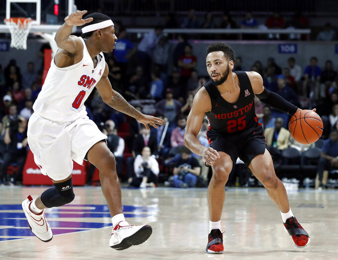 SMU's Jahmal McMurray (0) defends as Houston guard Galen Robinson Jr. (25) advances the ball up court in the second half of an NCAA college basketball game, Wednesday, Jan. 16, 2019, in Dallas. (AP Photo/Tony Gutierrez)