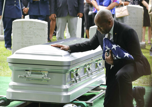 FILE- In this June 15, 2019 file photo, Christopher C. Morgan touches the casket of his son, West Point Cadet Christopher J. Morgan, during the interment ceremony at the United States Military Academy in West Point, N.Y. Military officials said on Tuesday, July 21, 2020 that Staff Sgt. Ladonies Strong was found guilty of negligent homicide in the vehicle rollover that killed Morgan, and was sentenced to three years confinement and a discharge for bad conduct. (Mark Vergari/The Journal News via AP, File)