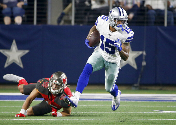 Dallas Cowboys wide receiver Devin Smith (15) escapes tackle attempt by Tampa Bay Buccaneers linebacker Jack Cichy (48) after catching a pass for a first down in the first half of a preseason NFL football game in Arlington, Texas, Thursday, Aug. 29, 2019. (AP Photo/Ron Jenkins)