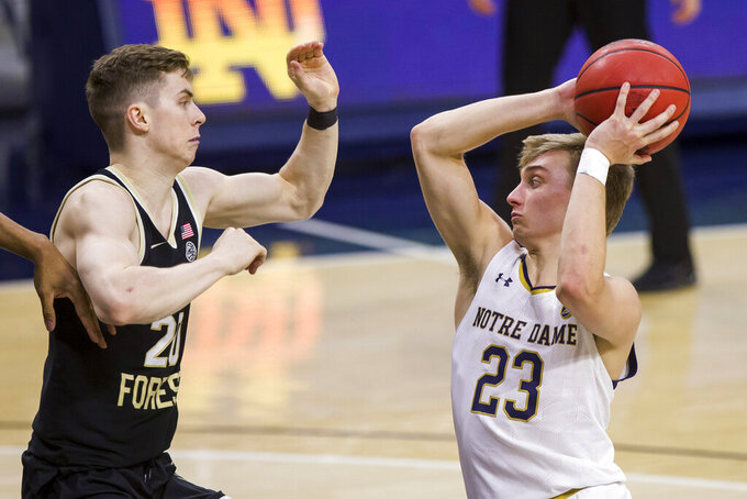 Notre Dame's Dane Goodwin (23) gets pressure from Wake Forest's Jonah Antonio (20) during the second half of an NCAA college basketball game Tuesday, Feb. 2, 2021, in South Bend, Ind. Notre Dame won 79-58. (AP Photo/Robert Franklin)