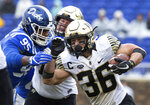 Wake Forest's Cade Carney (36) carries the ball past the reach of Duke's Trevon McSwain (95) during the first half of an NCAA college football game in Durham, N.C., Saturday, Nov. 24, 2018. (AP Photo/Ben McKeown)