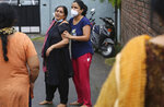 Relatives of Rakesh Pandita, a politician who was killed late Wednesday, mourns at their residence in Jammu, India, Thursday, June.3, 2021. Assailants fatally shot the politician belonging to India's ruling party in disputed Kashmir, police said Thursday, blaming separatist rebels for the attack. The unidentified assailants fired at Pandita late Wednesday in the southern town of Tral, where he was visiting a friend, police said. He was declared dead in a hospital. (AP Photo/Channi Anand)