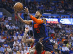 Oklahoma City Thunder forward Paul George (13) collides with Houston Rockets guard James Harden, bottom, and is called for a foul during the second half of an NBA basketball game Tuesday, April 9, 2019, in Oklahoma City. (AP Photo/Sue Ogrocki)