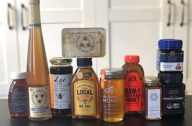 This February 24, 2020 photo taken in New York, shows some of the many brands and types of honey available today. Honey isn't just honey anymore. At farmers markets, grocery stores and restaurants, there's a wide assortment of honeys with various colors and tastes. (Katie Workman via AP)