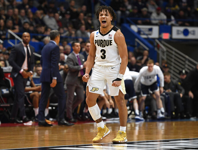 Purdue's Carsen Edwards (3) reacts during the first half of a second-round men's college basketball game against Villanova in the NCAA tournament, Saturday, March 23, 2019, in Hartford, Conn. (AP Photo/Jessica Hill)